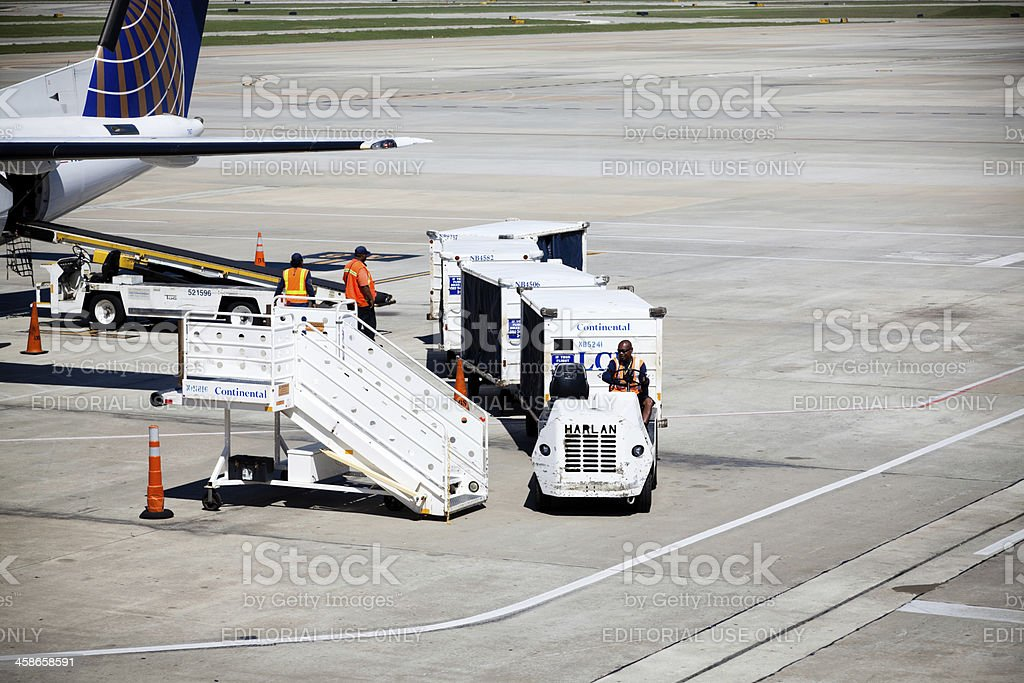 Loading luggages in the airport stock photo