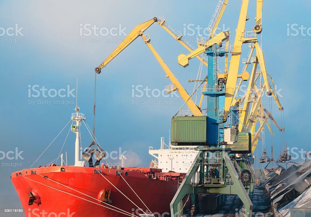 Loading of coal on the freighter. stock photo