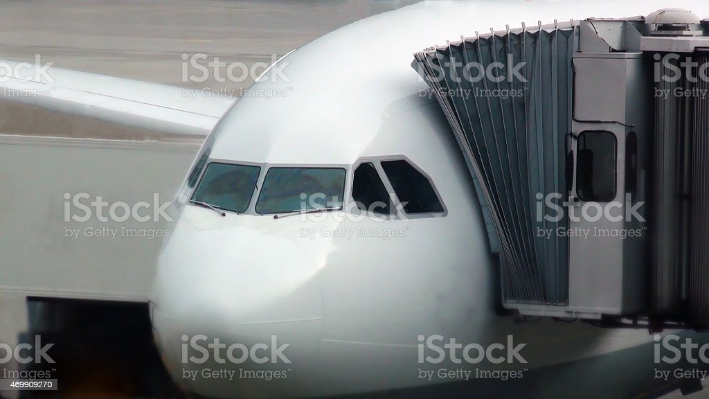 Loading of passengers airplane stock photo