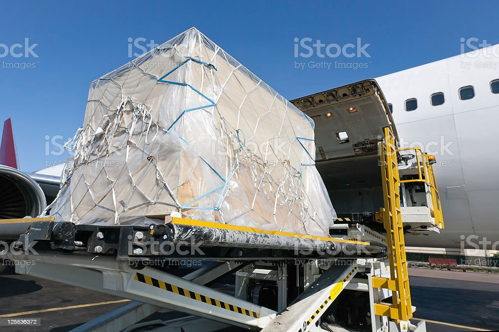 Loading shipment on an airplane royalty-free stock photo
