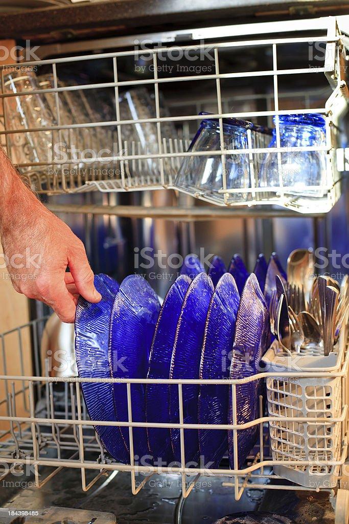 loading the dishwasher royalty-free stock photo