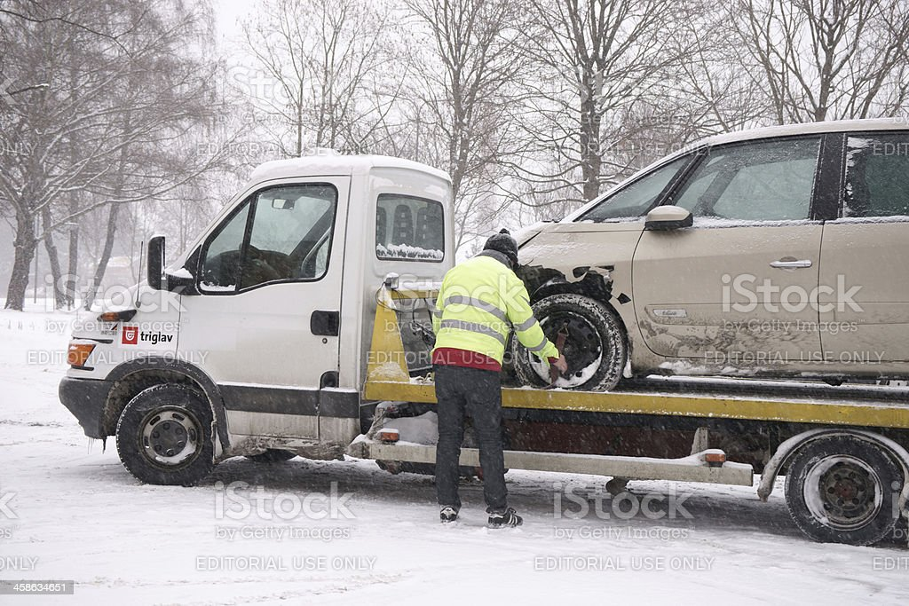 Loading wrecked car on the truck stock photo