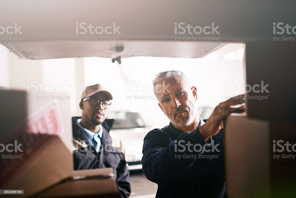 Loading your goods with the utmost care stock photo