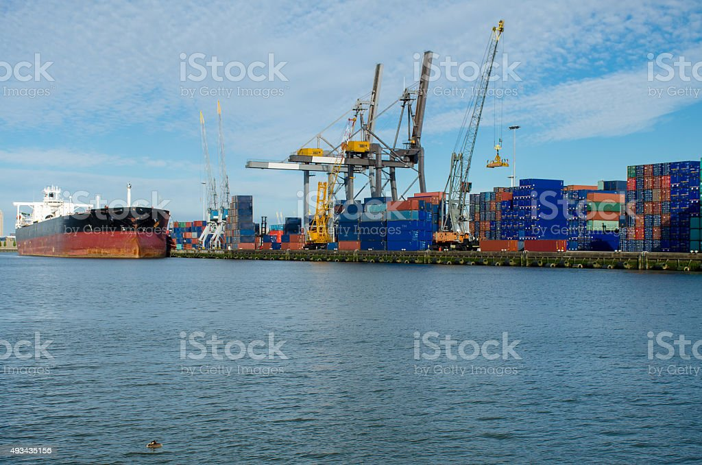 Loading/unloading shipping containers in the port of Rotterdam, Netherlands. stock photo