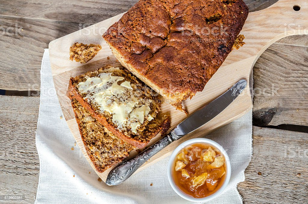 Loaf of banana bread with apple confiture stock photo