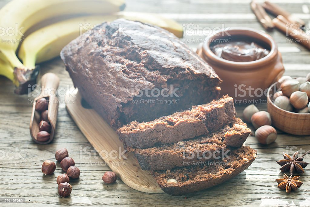 Loaf of banana-chocolate bread with chocolate cream stock photo