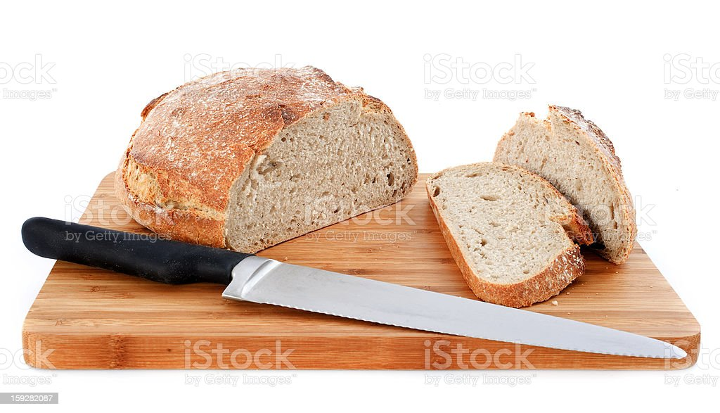 loaf of bread and knife royalty-free stock photo