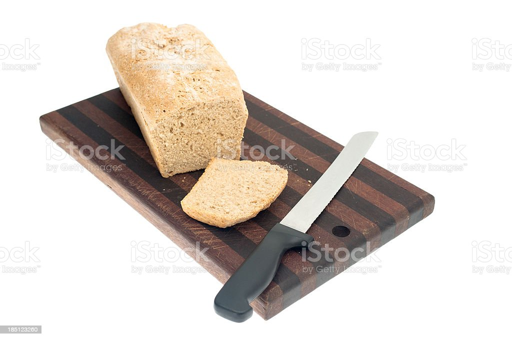 Loaf of Bread on Cutting Board stock photo