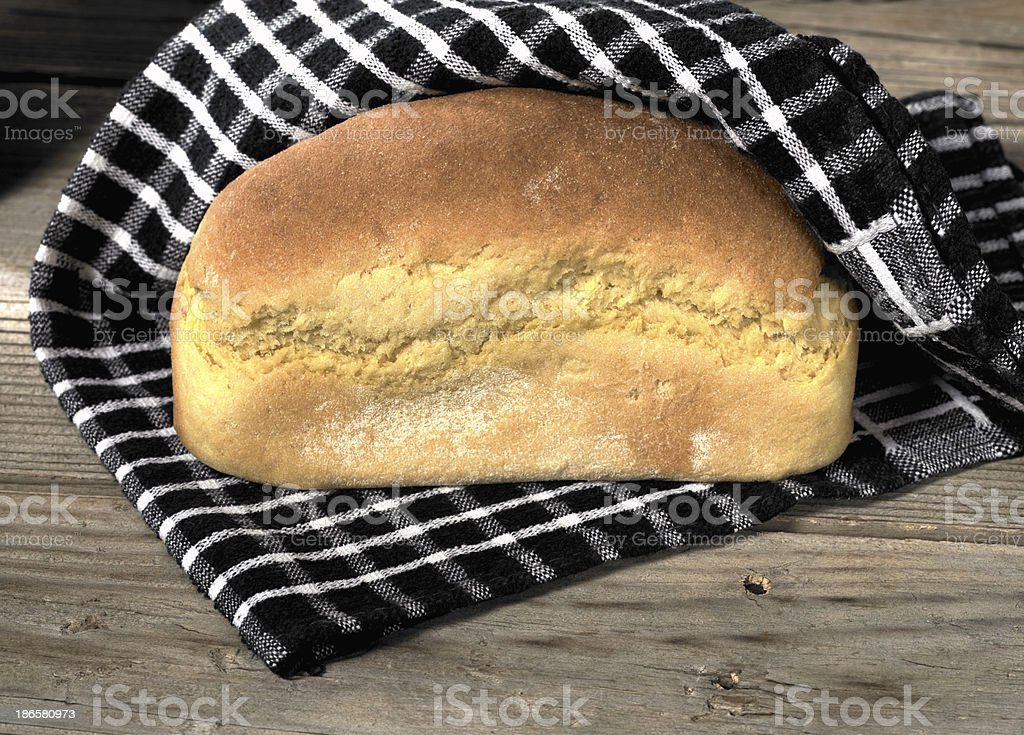 Loaf of bread on wooden surface royalty-free stock photo