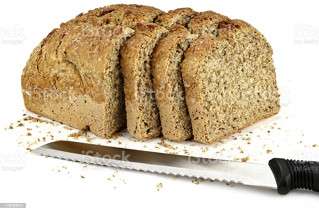 loaf of bread with a three slices and knife royalty-free stock photo