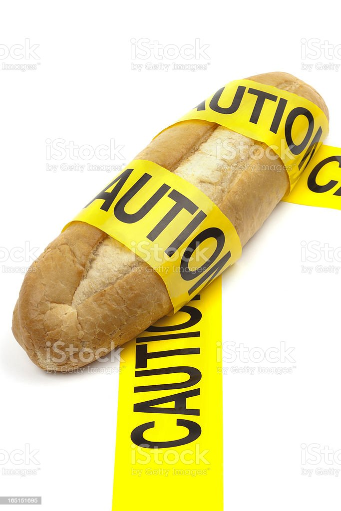 Loaf of bread with caution tape royalty-free stock photo