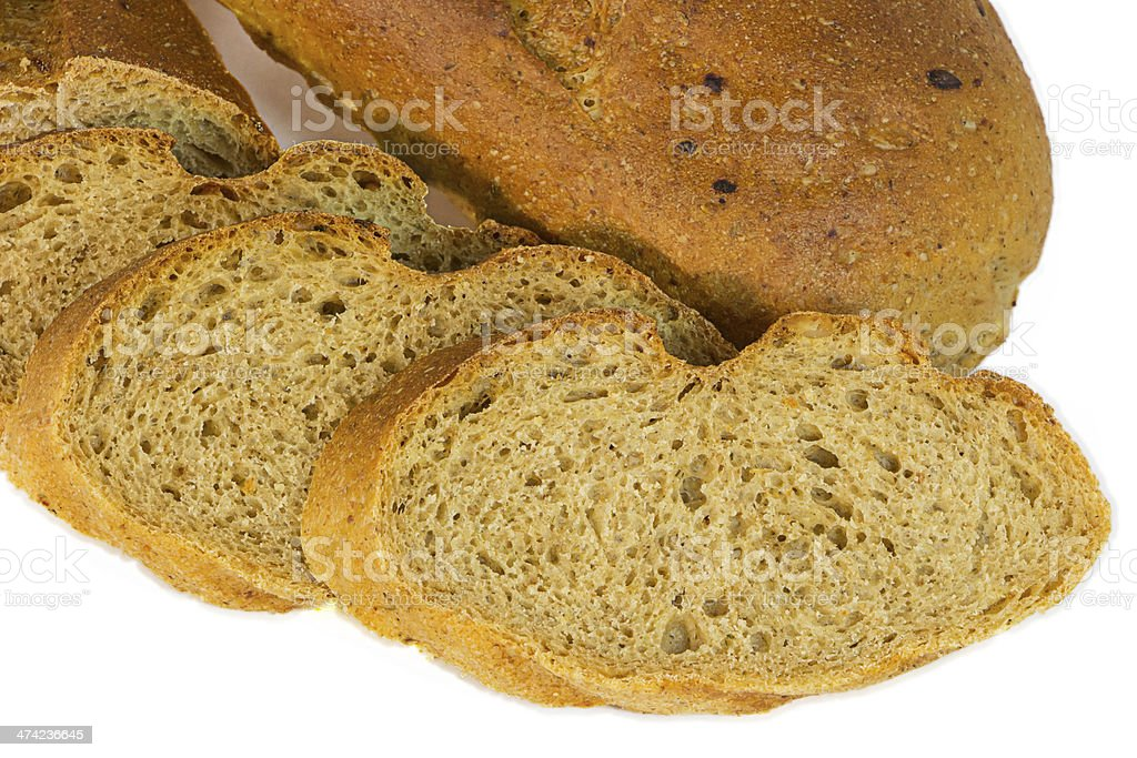 Loaf of bread with sliced piaces royalty-free stock photo