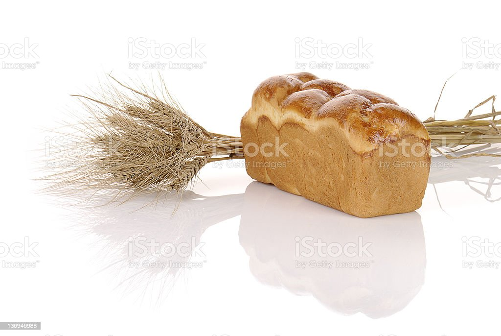 loaf of bread with spikelets royalty-free stock photo