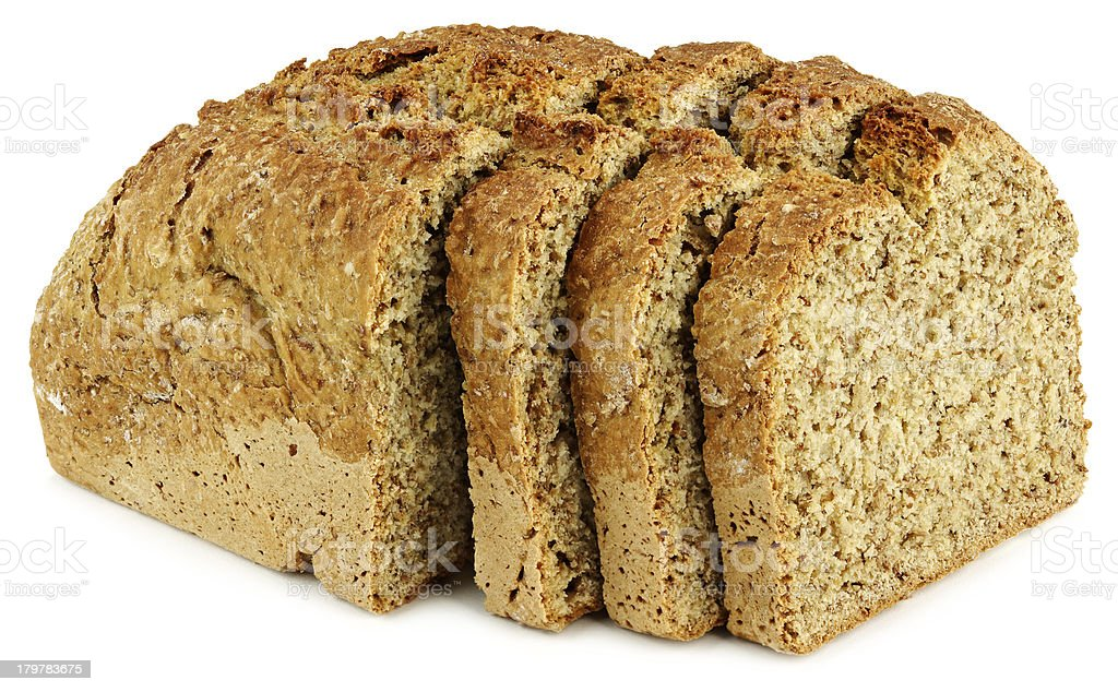 loaf of bread with three slices on a white table royalty-free stock photo