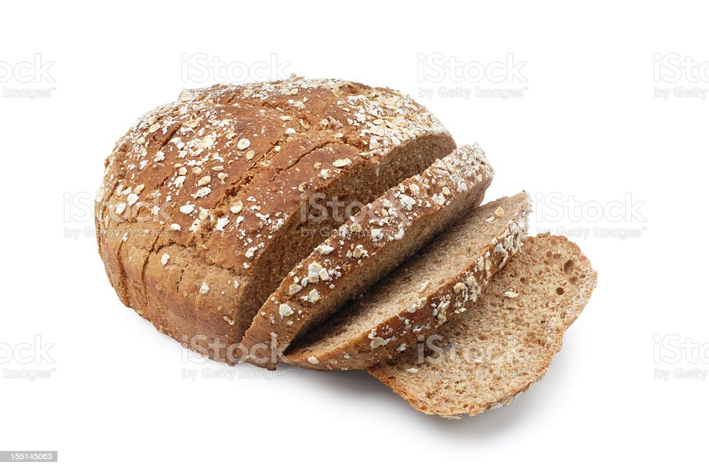 A loaf of brown sesame seed bread with three slices cut stock photo