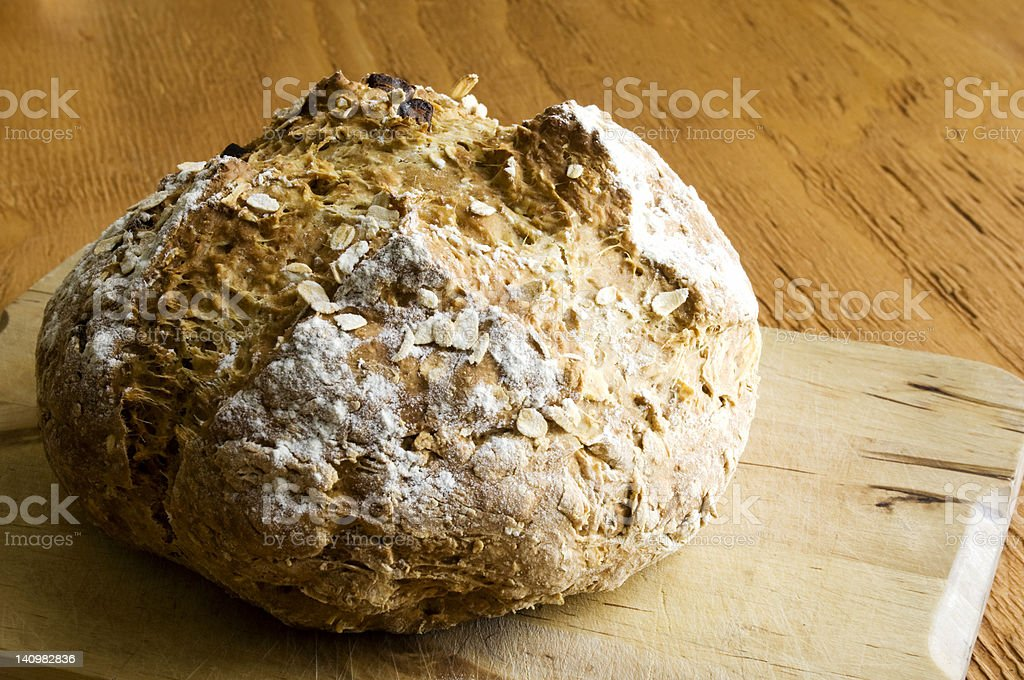 Loaf of Irish Soda Bread on Wooden Tabletop royalty-free stock photo