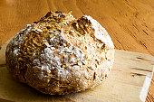 Loaf of Irish Soda Bread on Wooden Tabletop