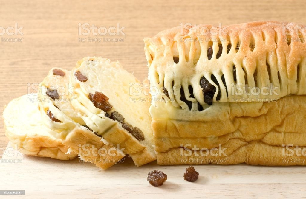 Loaf of Raisin Bread on Wooden Cutting Board stock photo