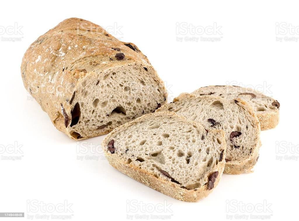 Loaf of wholemeal olive infused bread with slices royalty-free stock photo