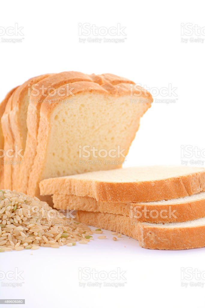 Loaf Rice Sourdough bread with raw brown rice. stock photo