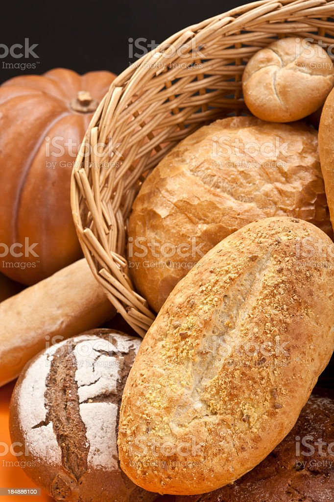Loafs Of Bread, Basket And Pumpkin stock photo