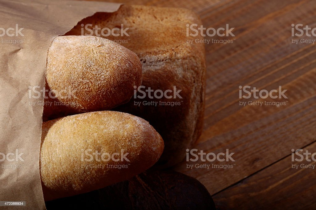 Loafs of bread in paper packet stock photo