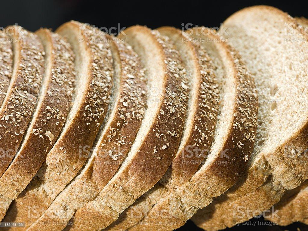 Loafs of multigrain bread in a row royalty-free stock photo