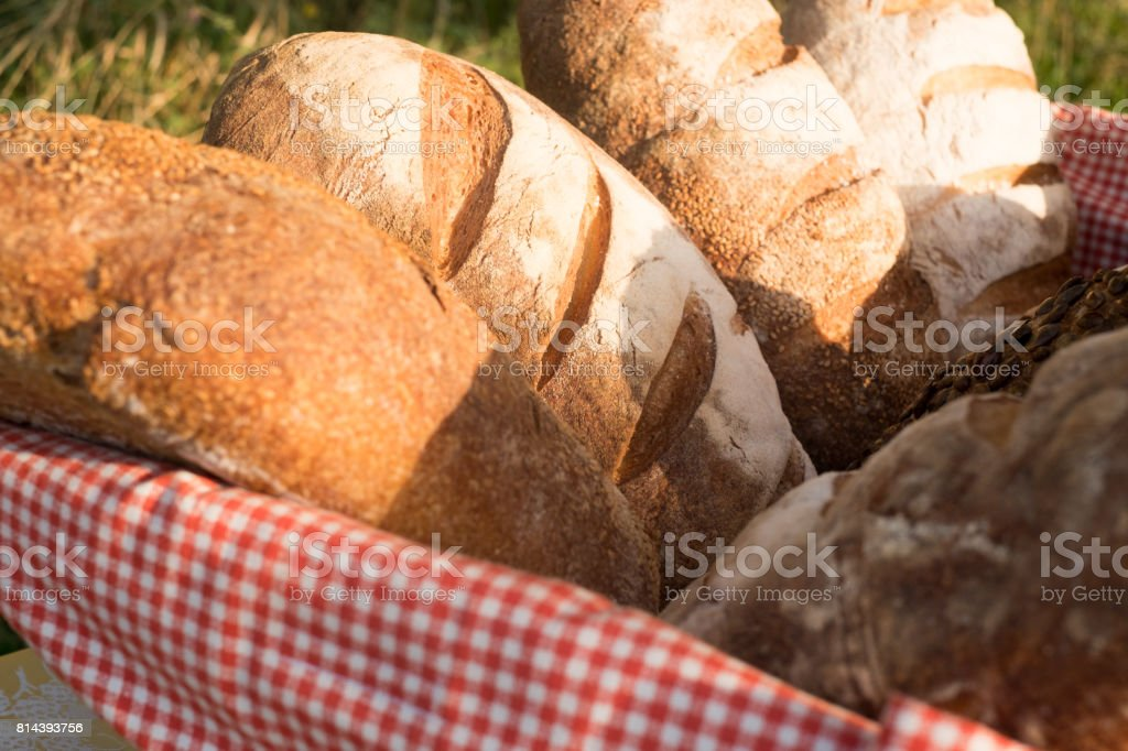 Loafs of traditional and natural bread in the basket stock photo