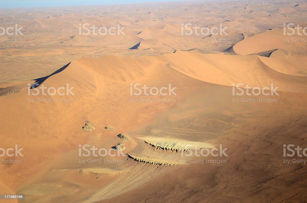 Loam soil appears under a big dune stock photo