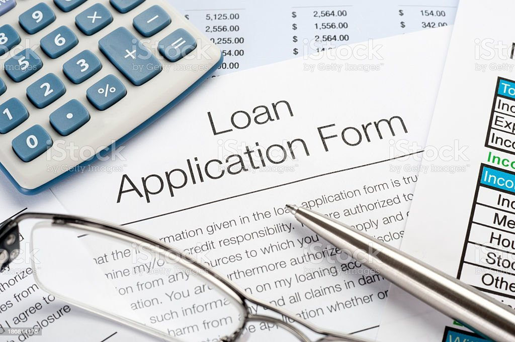 Loan Application Form with pen, calculator stock photo