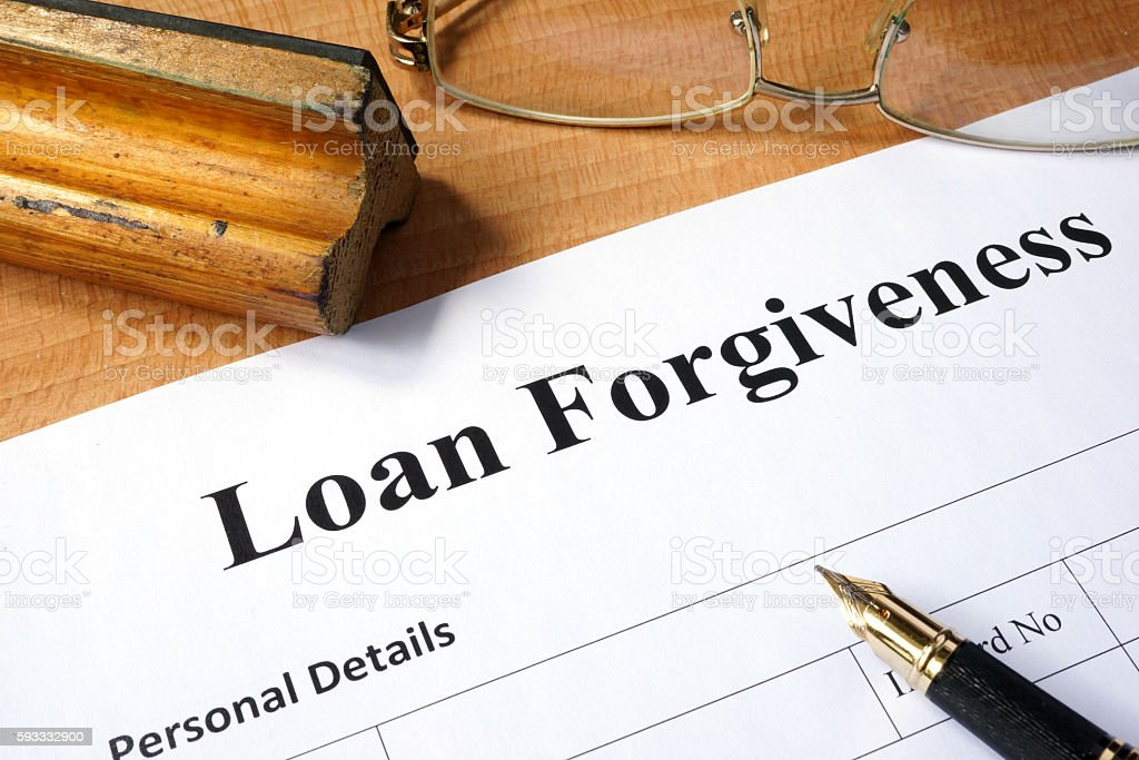 Loan forgiveness form on a wooden table. stock photo