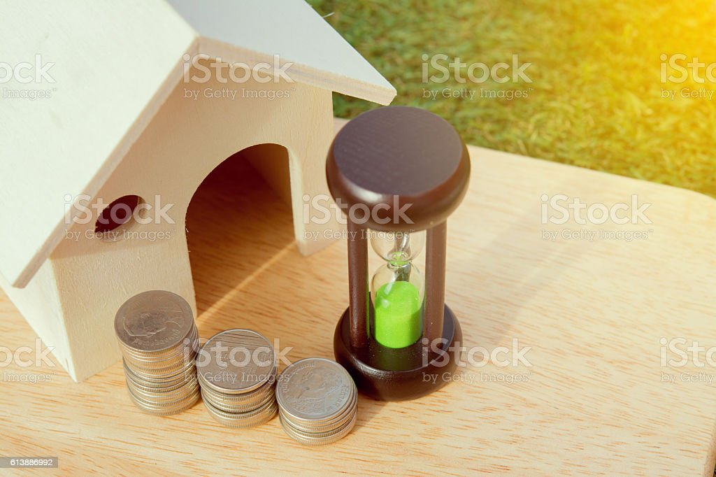 Loans to finance home building.Money Hourglass home. stock photo
