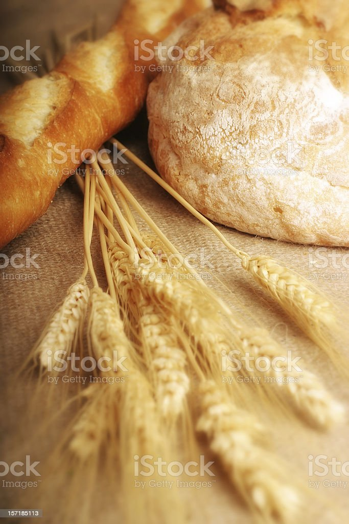 Loaved of Bread with Stalks of Wheat royalty-free stock photo