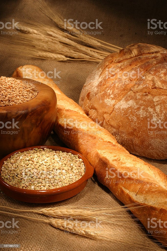 Loaves of Breads with wheat grains royalty-free stock photo