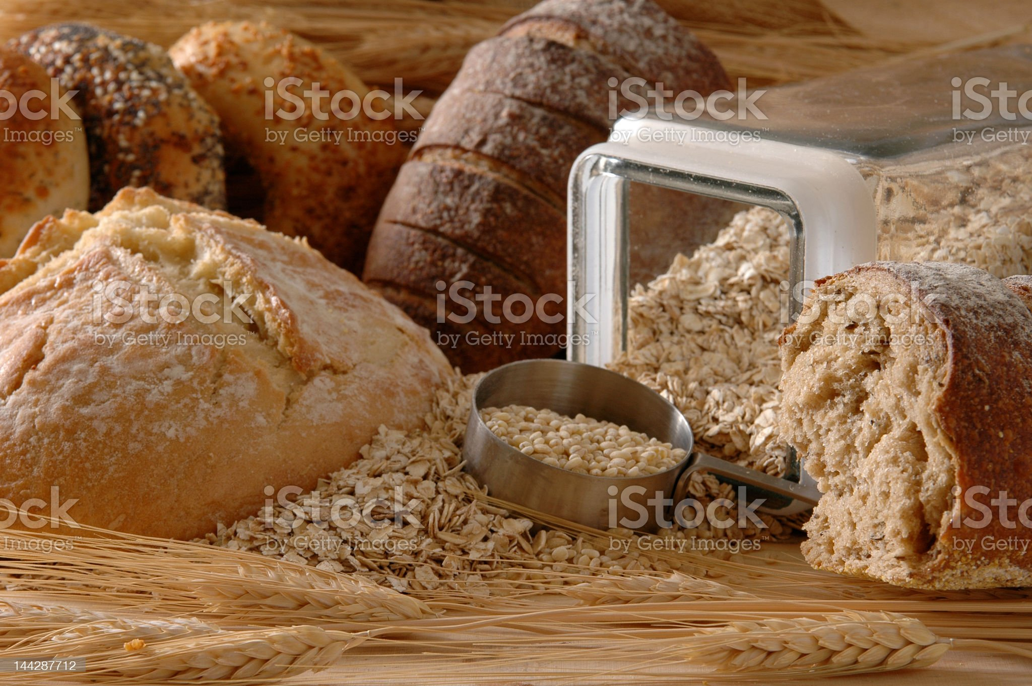 Loaves of different types of bread and a jar of oats royalty-free stock photo
