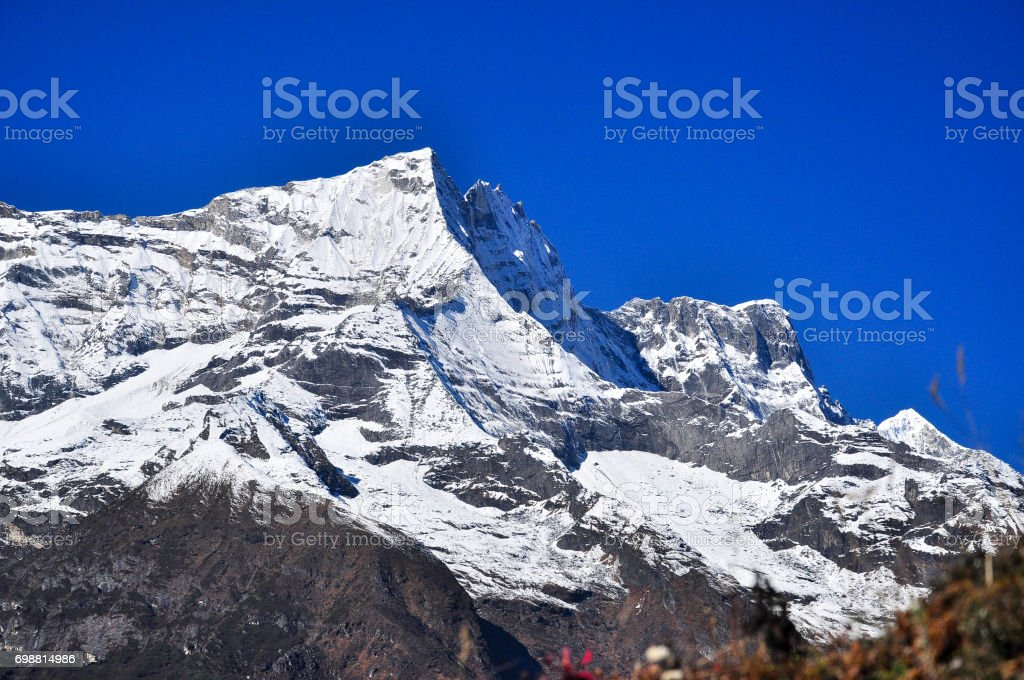 lobche and sulight flare from everest trek stock photo