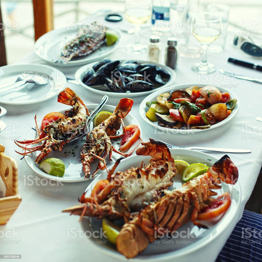Lobster and vegetables in typical greek taverna, Crete stock photo