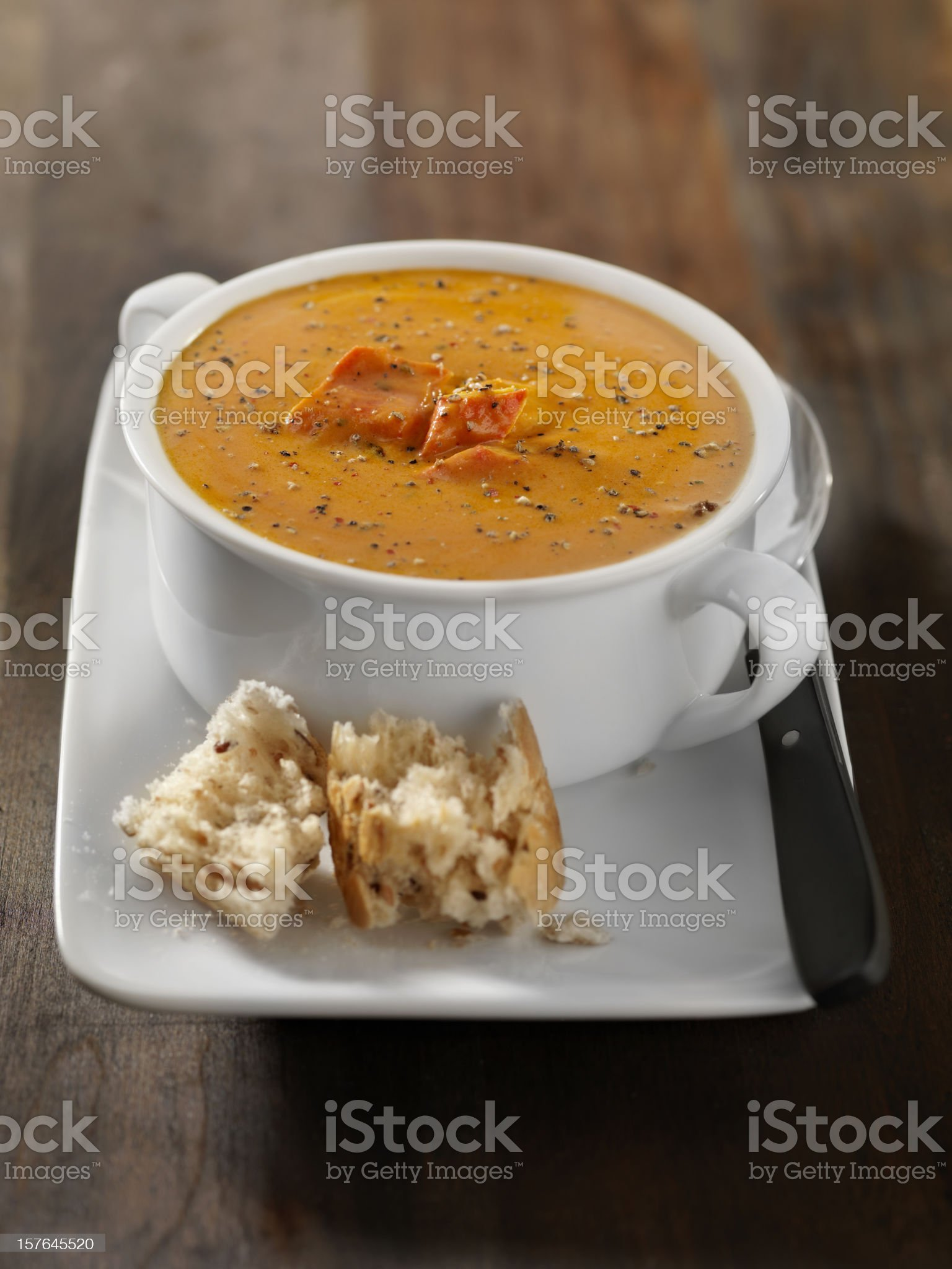 Lobster Bisque with Crusty Bread royalty-free stock photo