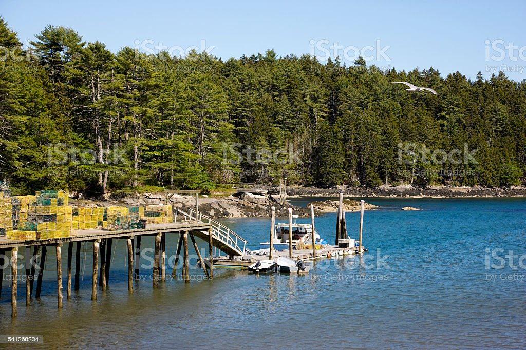 Lobster boats at the dock in Maine quiet harbor stock photo