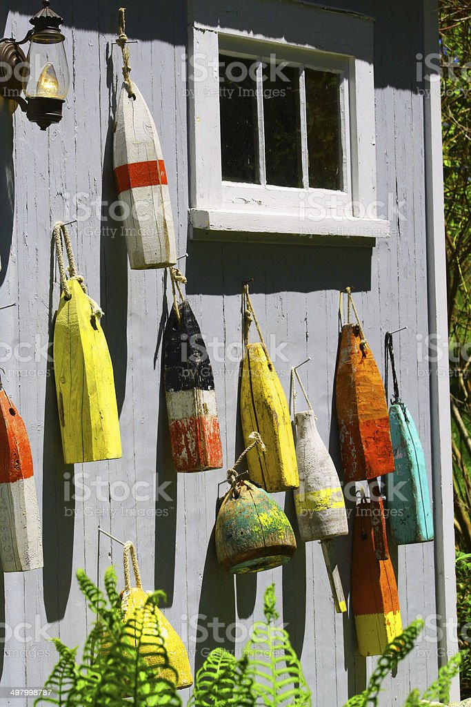 Lobster Buoys on a Wall stock photo