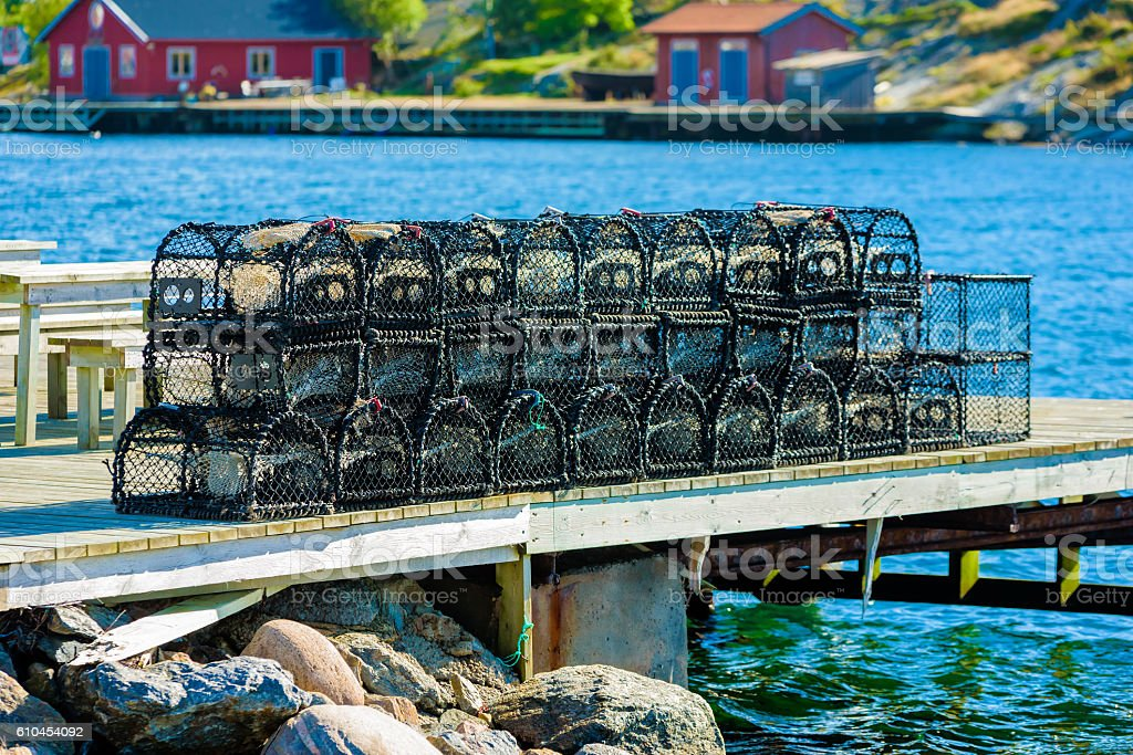 Lobster cages on pier stock photo