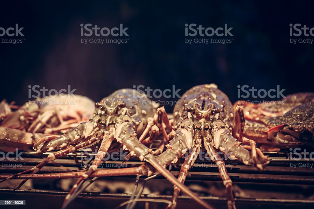 Lobster cooking on grill barbecue stock photo