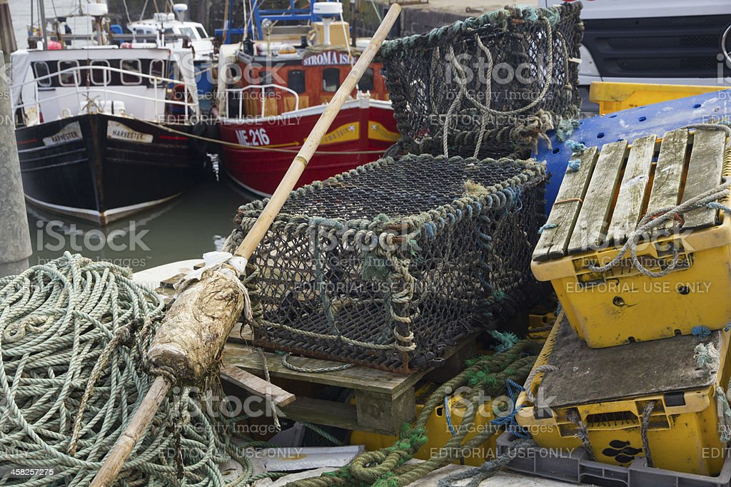 Lobster Pots and Fishing Boats in Commercial Harbour royalty-free stock photo