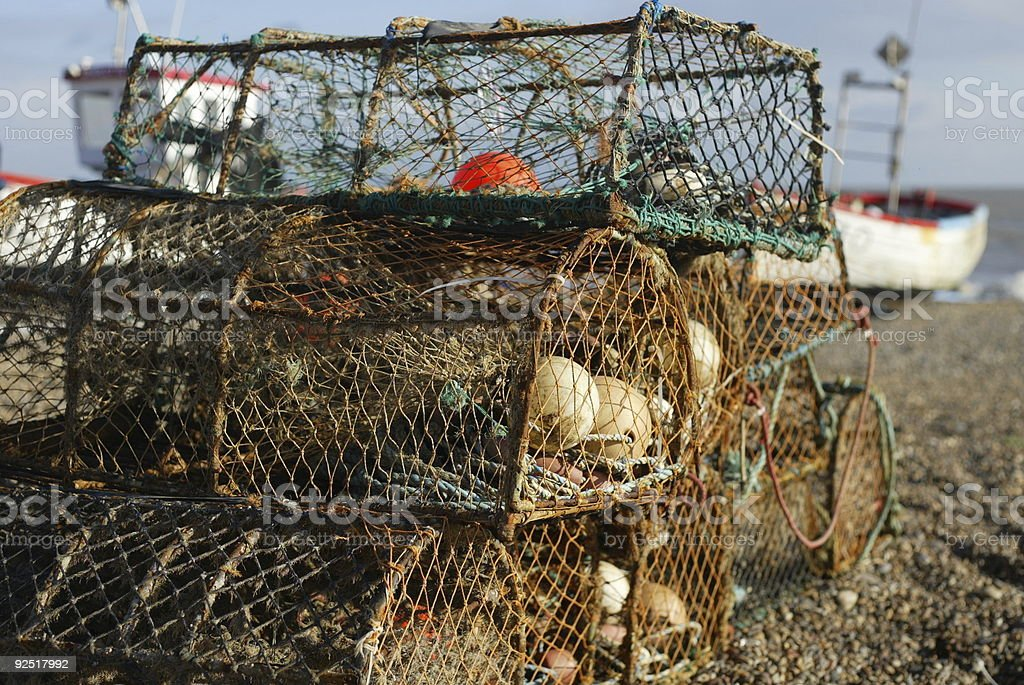 Lobster Pots on Beach stock photo