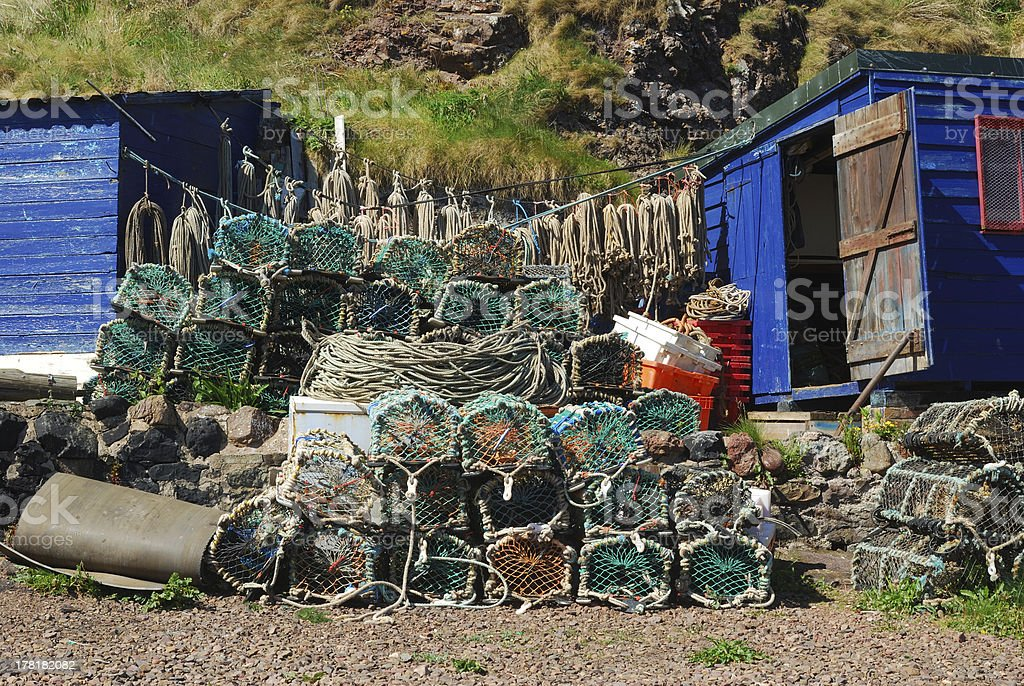 lobster pots, ropes, boxes and hut at St. Abbs harbour stock photo