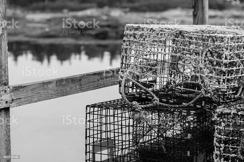 Lobster Pots with Coastal Reflection in BLack and White royalty-free stock photo