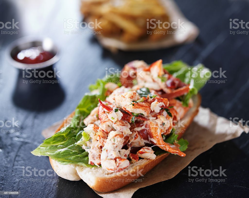 lobster roll on slate surface stock photo