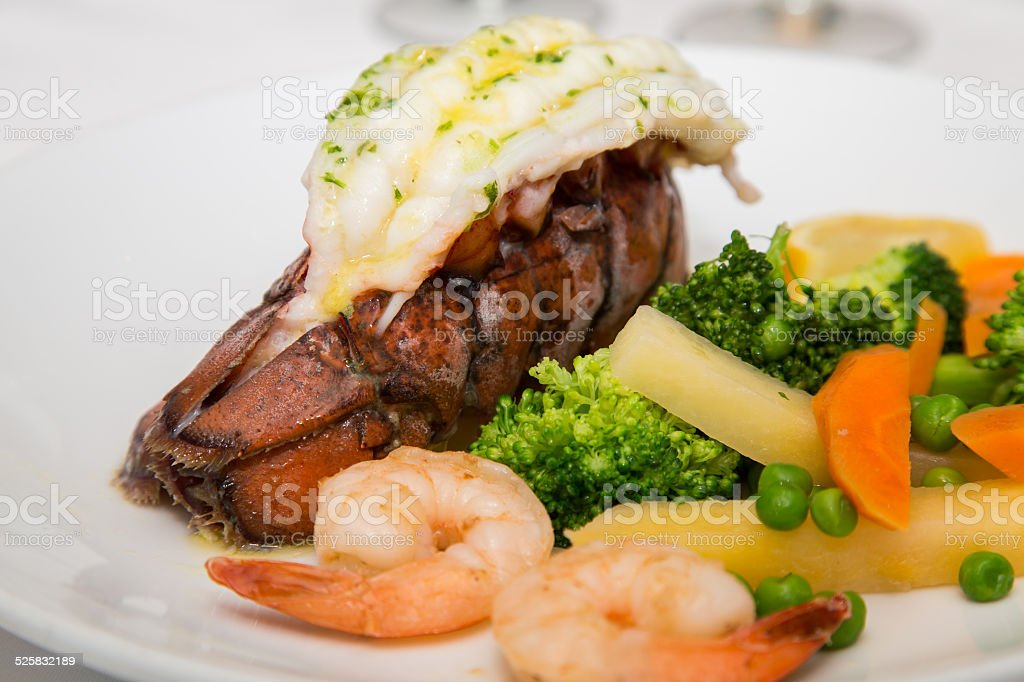 Lobster Tail with Shrimp and Vegetables stock photo