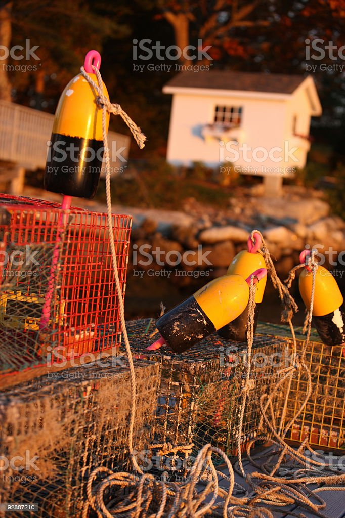 Lobster traps in sunset light stock photo
