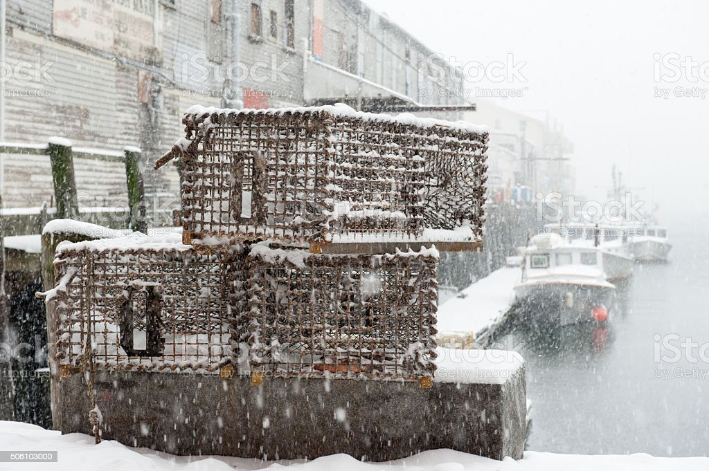 Lobster traps on a pier during a snowstorm in Maine stock photo